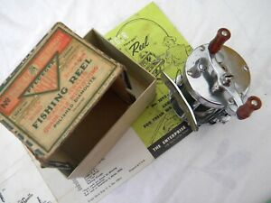Vintage-Boxed-Pflueger-Akron-and-paper-work-1956