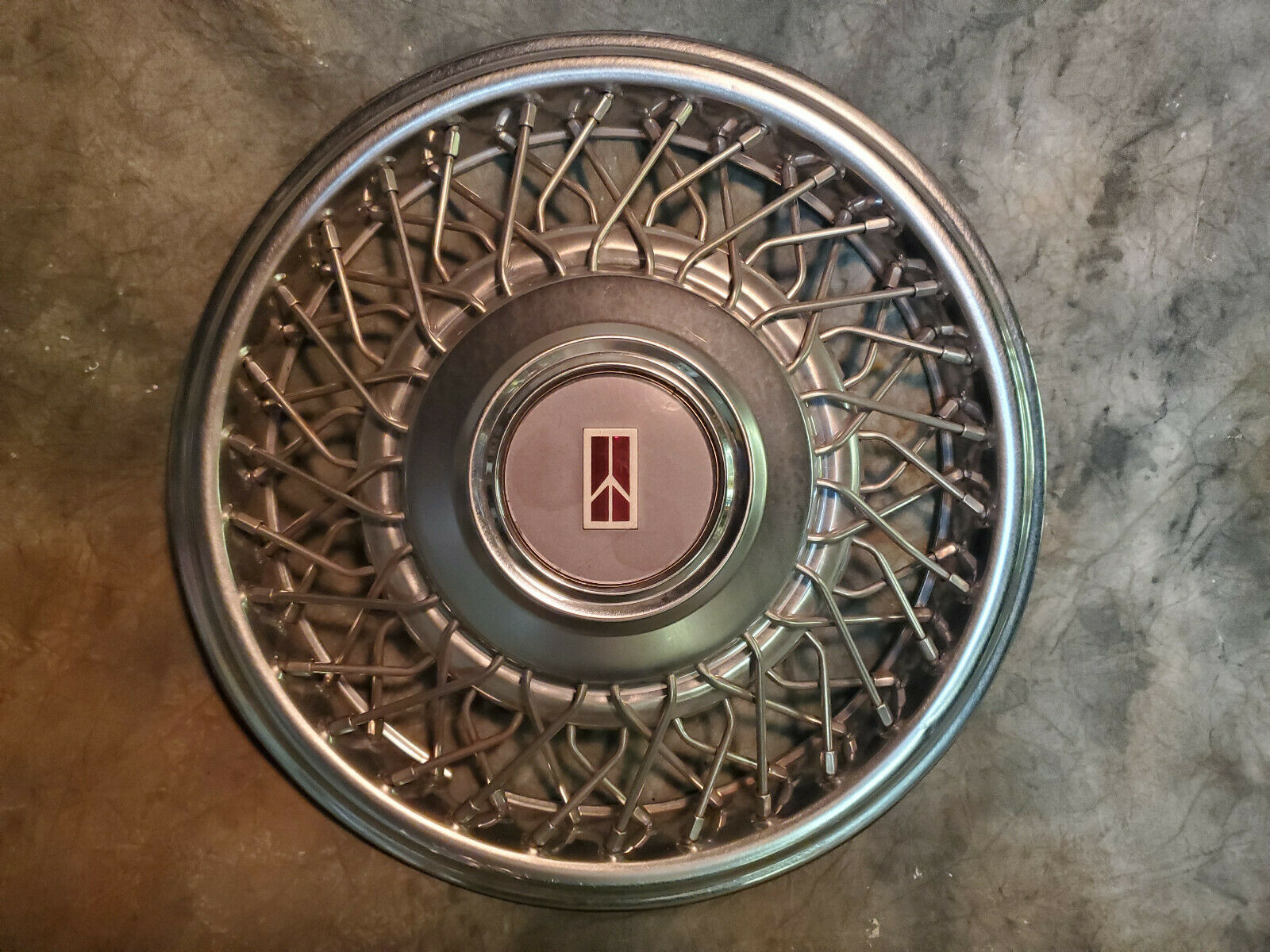 GM OEM NOS 14091905 Wheel Cover Lock Bracket