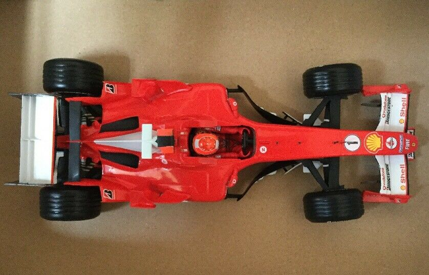 Toison aime les Jeux olympiques, la phrase d'or envoie un cadeau Ferrari f2005 f1 Michael Schumacher 2005 Minichamps 1:18 (#3.6) | Choix Des Matériaux