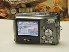 Nikon Coolpix L2 6MP Digital Camera 3x Optical Zoom Lens, 2GB SD Card, Batteries