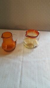 Set Amberina hand blown small pitchers with applied handles unmarked