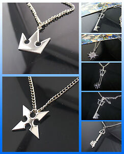 Kingdom hearts sora crown roxas cross keyblade necklace pendant image is loading kingdom hearts sora crown roxas cross keyblade necklace aloadofball Gallery