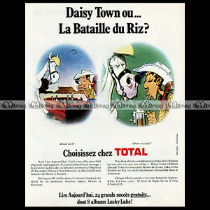 """LUCKY LUKE & les STATIONS TOTAL (Morris) 1975 Pub / Publicité / Advert Ad #A975 - France - État : Occasion : Objet ayant été utilisé. Consulter la description du vendeur pour avoir plus de détails sur les éventuelles imperfections. Commentaires du vendeur : """"Trés bon état"""" - France"""