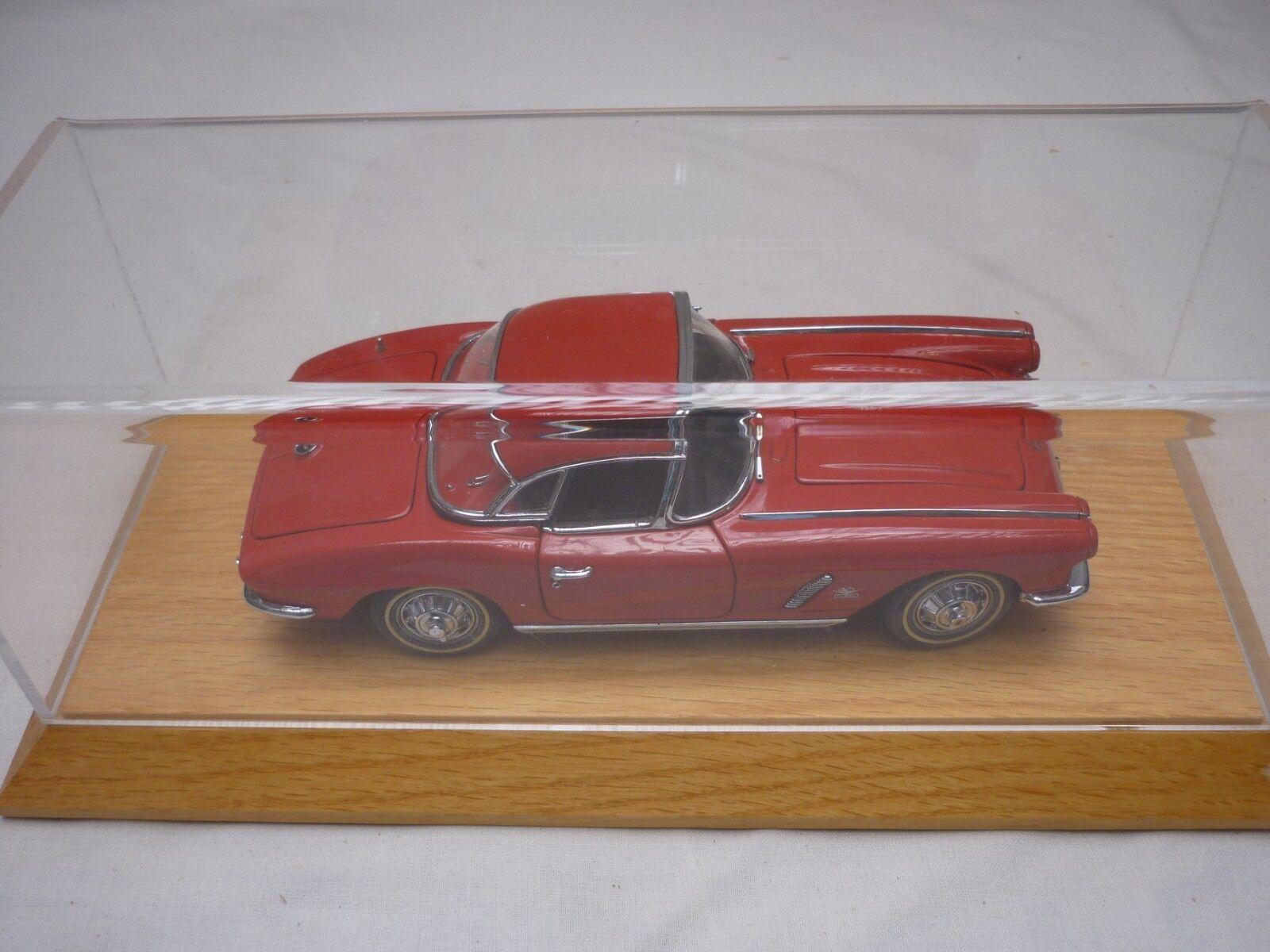A Danbury mint scale model of a 1962 Chevrolet Corvette,  display case.