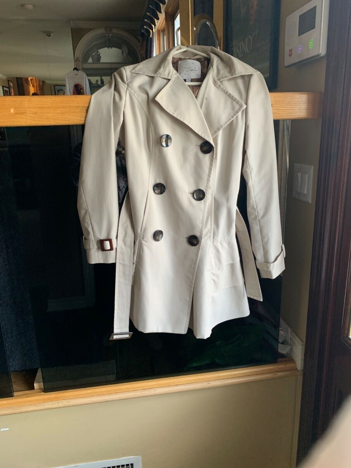 Very fashionable spring women's trench coat with belt  Size 4
