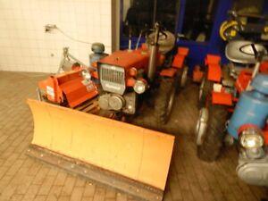 traktor tz4k14 mit schneeschild und bodenfr se schneepflug. Black Bedroom Furniture Sets. Home Design Ideas