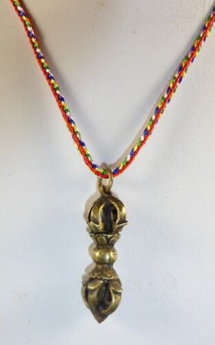 BRONZE VAJRA DORJE PROTECTION PENDANT AMULET FROM NEPAL MULTI COLOURED CORD.