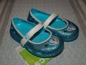 8699954bc934 Crocs Girls' Keeley Disney Frozen Flat Blue Glitter Anna Elsa Mary ...