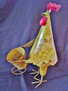 ancien-pot-de-fleur-artisanat-d-039-art-en-tole-et-metal-coq-poussant-une-brouette