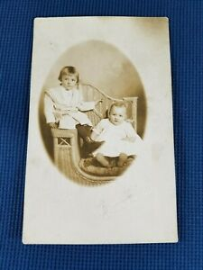 Vintage-Real-Photo-Post-Card-2-Children-in-Wicker-Chair-AZO-1910-039-s-Bijou-Studio