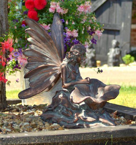 fairy kneeling . made from cast resin garden ornament