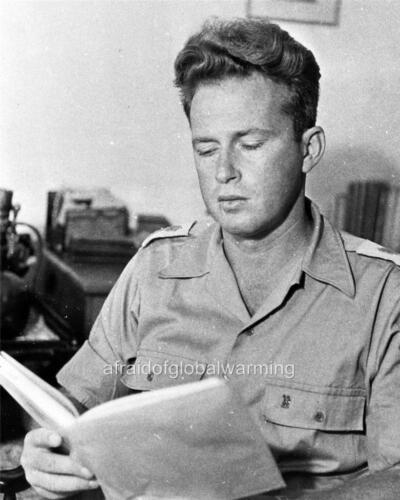 Israel Yitzhak Rabin reading Photo 1948