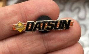 Datsun enamel pin NOS vintage 80s car auto hat lapel bag automobile logo model
