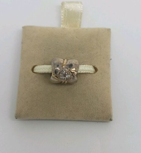 CHAMILIA STERLING SILVER AND 14 K GOLD CHARM