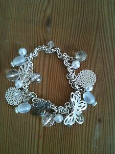 WHITE AND SILVER ELASTICATED BEADED BRACELET - <span itemprop=availableAtOrFrom>Wallington, Surrey, United Kingdom</span> - WHITE AND SILVER ELASTICATED BEADED BRACELET - Wallington, Surrey, United Kingdom