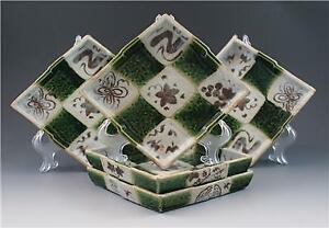 Oribe dish Japanese stoneware green and black pattern of grey green leaves and line shape of diamonds on a beige background