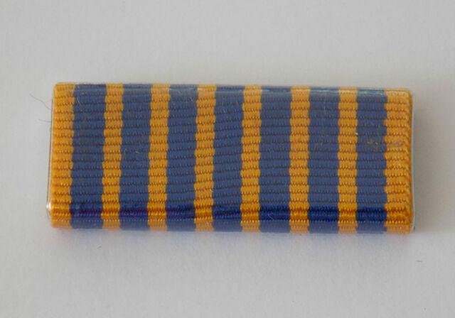 NATIONAL MEDAL RIBBON BAR PLASTIC COVERED. RIBBON BAR HAS 2 PINS