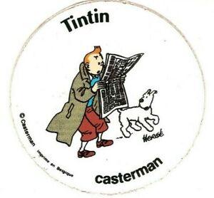 Herge-Tintin-lisant-le-journal-Autocollant-pub-Casterman