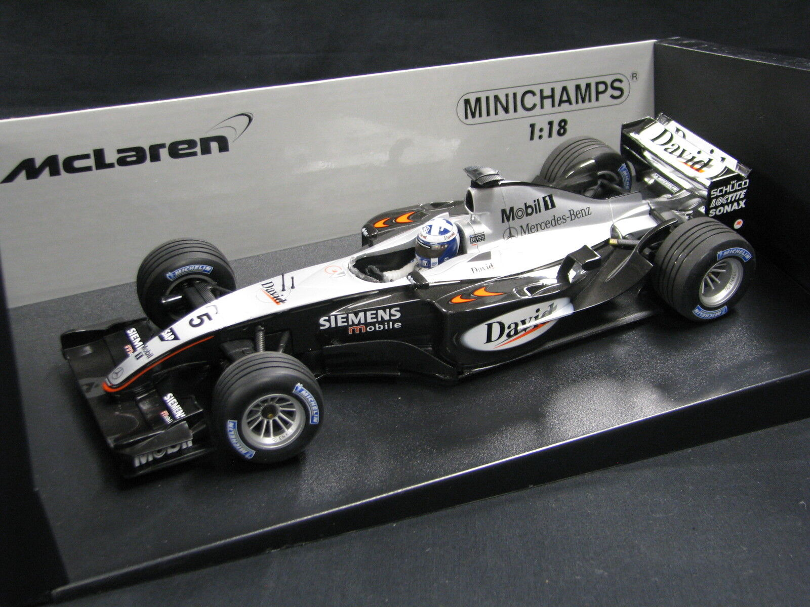 Minichamps McLaren Mercedes MP4 18 2003 1 1 1 18 Coulthard (FIN) Testcar (JS) 42c4f1