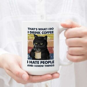 Black-Cat-That-039-s-What-I-Do-I-Drink-Coffee-I-Hate-People-And-I-Know-Things-Mug