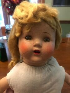 Antique-composition-doll-with-blonde-hair