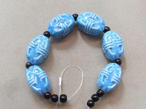 6 Aqua 22x15mm,And 11 Black 5mm Porcelain Beads (G82H15)