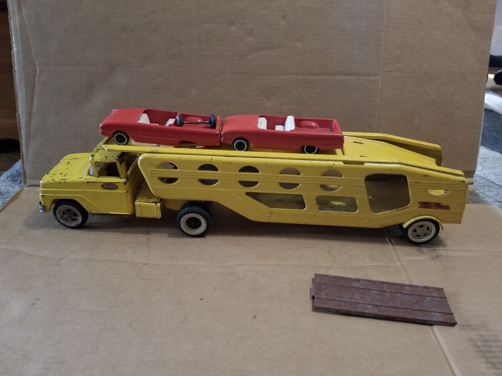 Tonka Yellow Car Carrier Hauler with 2 cars and ramp 1960's PRESSED STEEL TOY