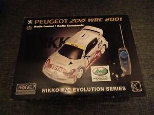 Système de commande radio Nikko Peugeot 206 Wrc.   Série Evolution.   Nouveau scellement