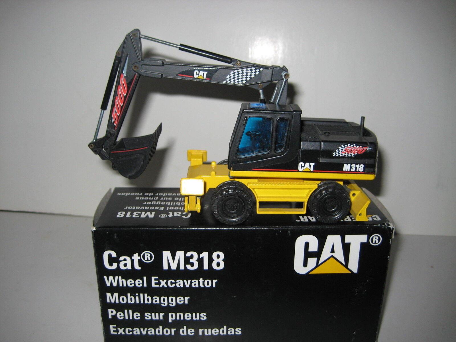 CATERPILLAR M 318 BAGGER TIEFLÖFFEL RACING  405.3 NZG 1 50 OVP