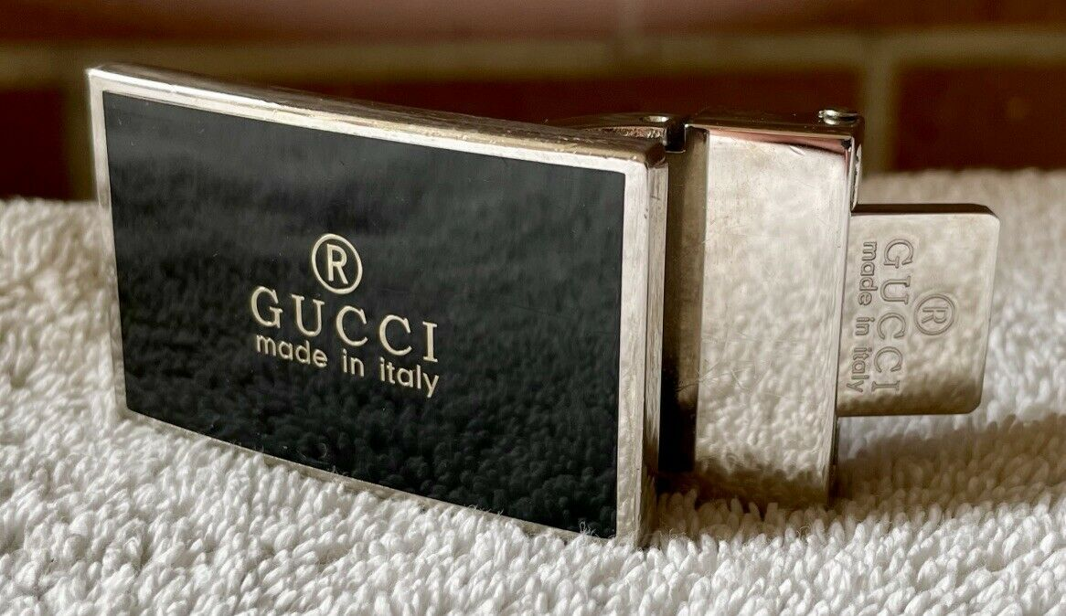 """""""® GUCCI, ... Italy"""" rectangular metal w/ black front, tang & pinch style buckle"""