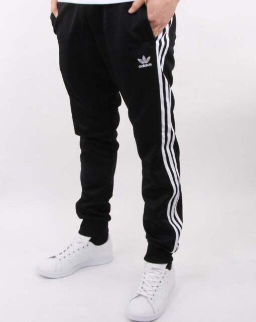 2692407a Adidas Originals Superstar Track Pants in Black - tracksuit bottoms, 3  stripe
