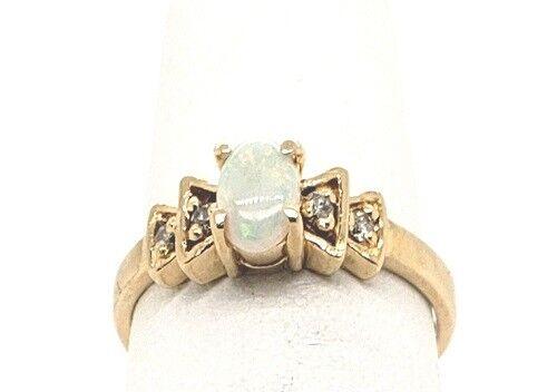 Genuine oval Opal 6x4 & Diamond .06tcw 14k yellow gold Fashion ring sz 6  NWOT