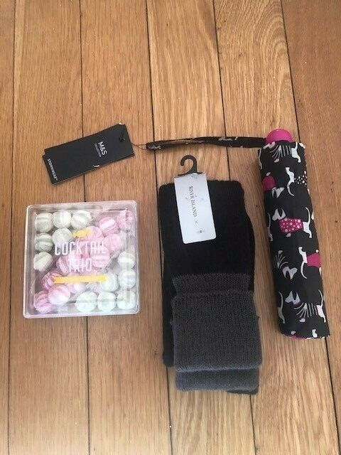 M&S sausage dog umbrella, River Island socks and box of cocktail sweets. New