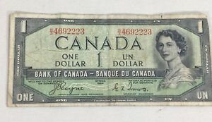 1954-Canadian-banknote-1-dollar-paper-money-Coyne-Towers-BA-4692223-devils-face