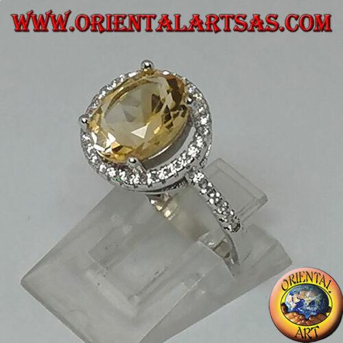Anello in argento 925‰ con topazio naturale sospesa su un cerchio di zirconi