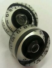 2 Guitar speed volume/tone knobs from 0-11. Pearl White/Black..   JAT