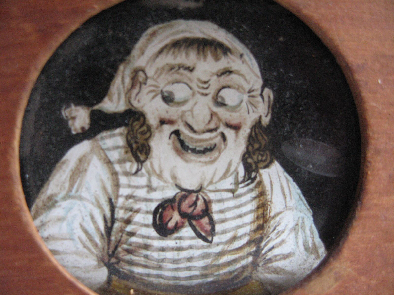 EARLY TOY PAINTED SAILORS FACE ON GLASS WITH MOVING EYES