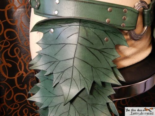 spring or fall color with fur option.LARP upper leg armor Leather leaf tasset