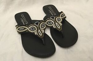 ebc23bbf634 Details about COCONUTS By Matisse Womens Size 10M Black Brass White Beaded  Flats Thong SANDALS