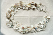 LONG STATEMENT NECKLACE_MULTI ROW WITH CREAMY DISCS WITH MOTHER OF PEARL FINISH