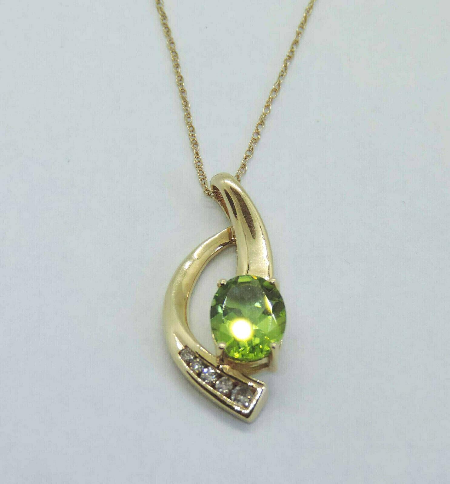 Ladies Genuine Oval Peridot Gemstone Pendant w  5 Gen. Dia. - 14k Yellow gold
