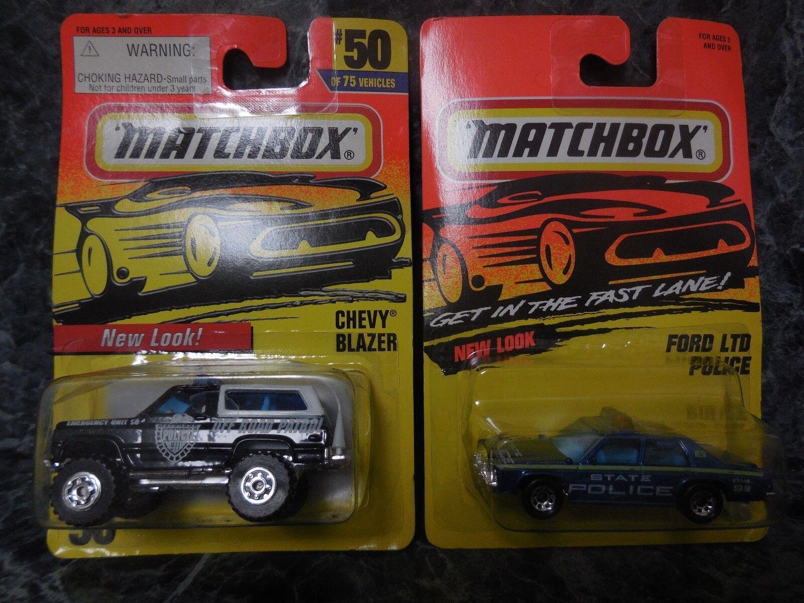 2 vintage matchbox police cars  1 1995 ford ltd state car  1996 chevy blazer