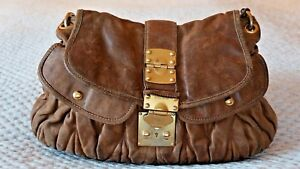 f49411bd17e classic miu miu matelasse quilted tan leather bag with vintage look
