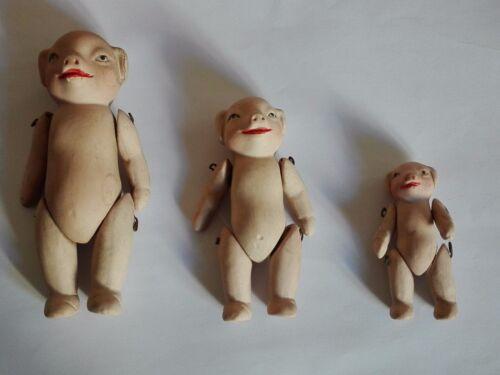 poupée en porcelaine biscuit Cochons