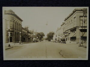 1941-NEW-LISBON-WI-Main-St-SIGNS-Rexall-Drug-OLD-STYLE-LAGER-Bank-Theater-RPPC