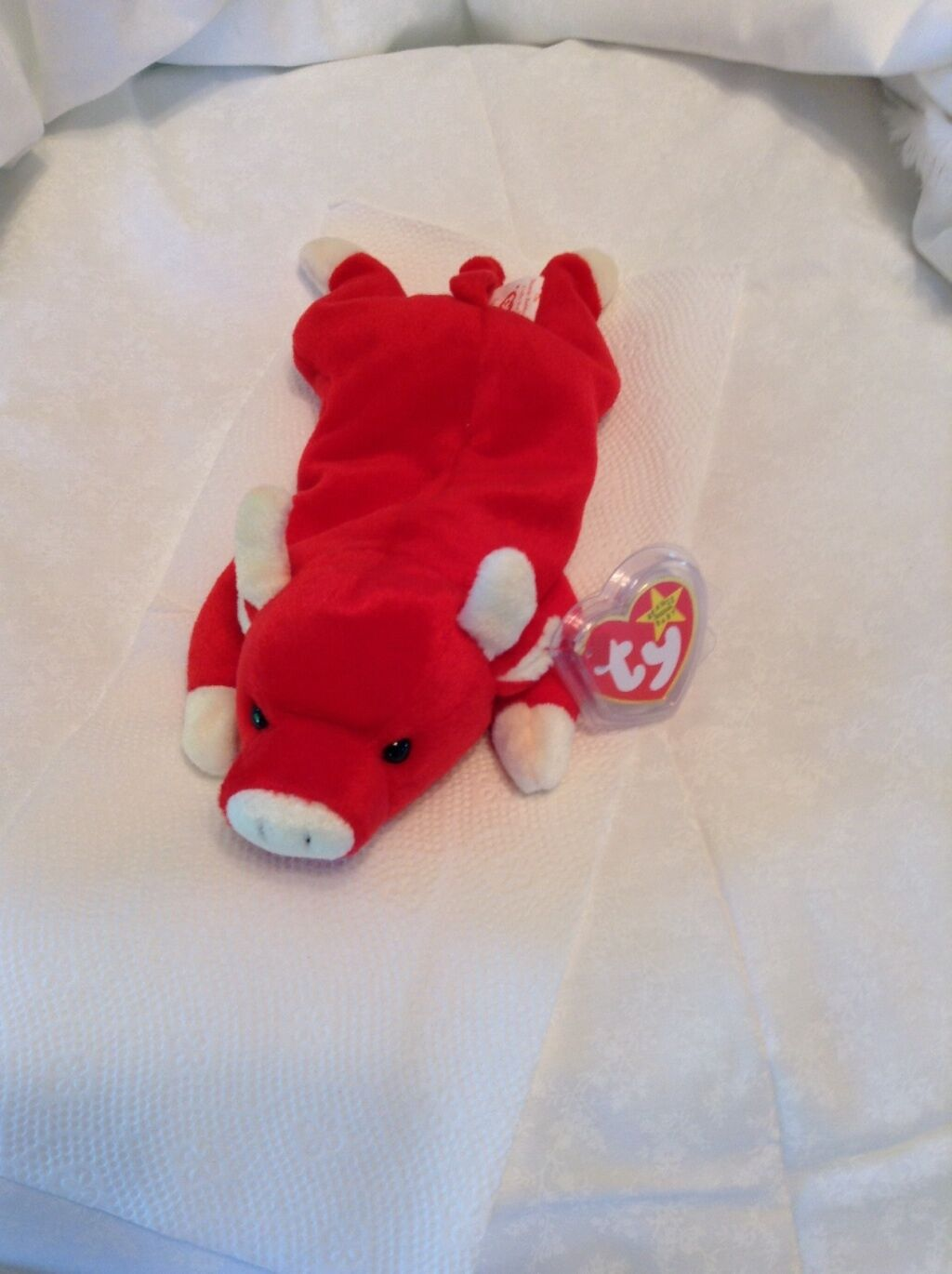 Snort the bull beanie baby with rare cream colord horns, ears, snout, and feet.