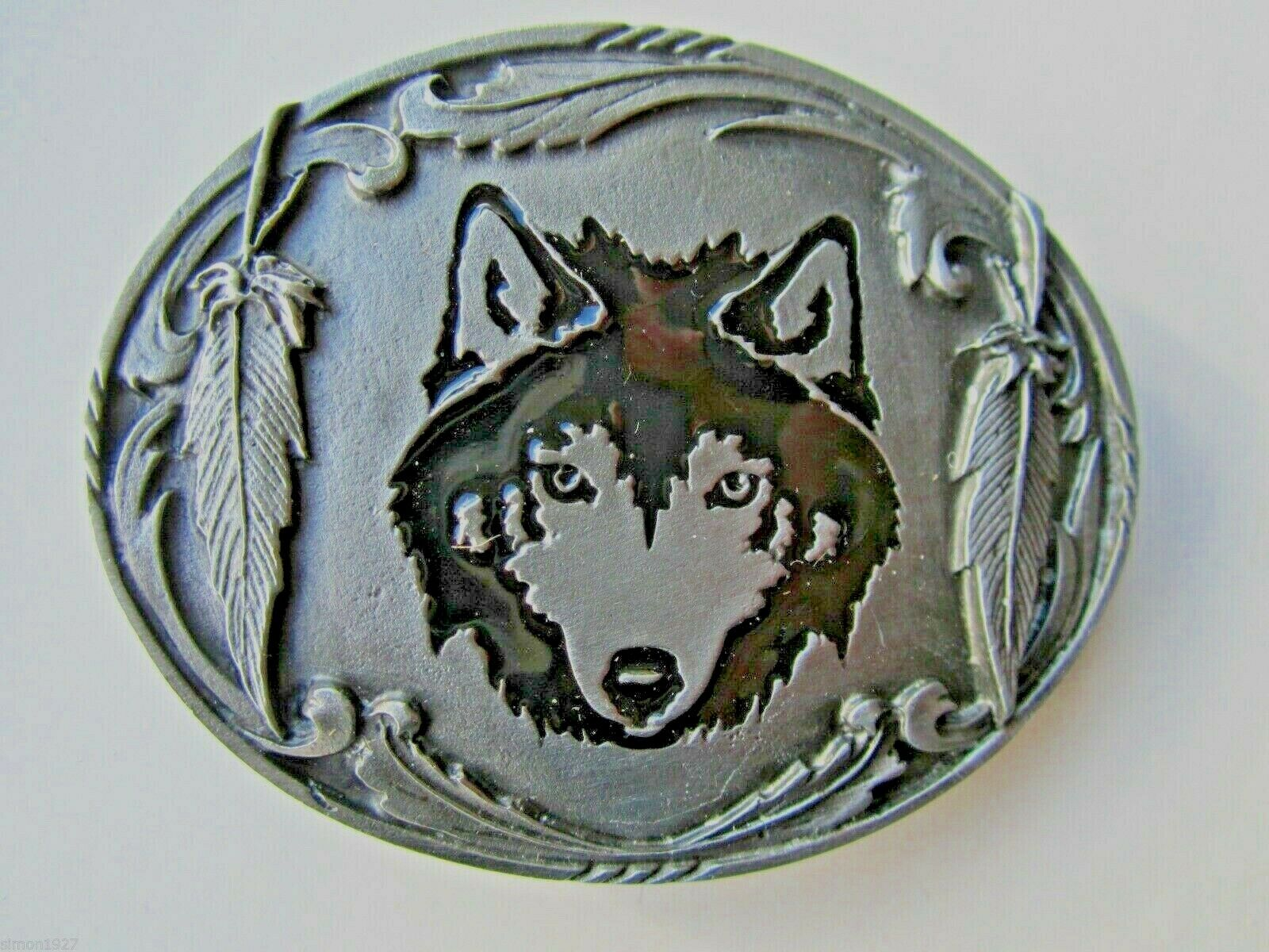 Wolf belt buckle wolf and feathers.
