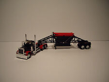 DCP 1/64 BLACK AND RED 379 PETE DAYCAB AND BLACK WITH RED TARP MANAC BOTTOM DUMP