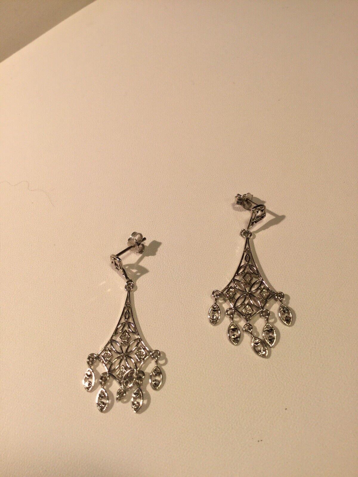 10 White gold And Diamond Dangle Earrings