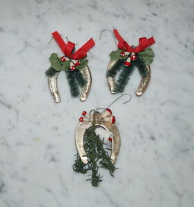 '3-antique-xmas-tree-ornaments-Dresden-Cardboard-Horse-Shoe-ca-1930-6486' from the web at 'https://i.ebayimg.com/images/g/JBYAAOSw8w1X4Bpa/s-l300.jpg'